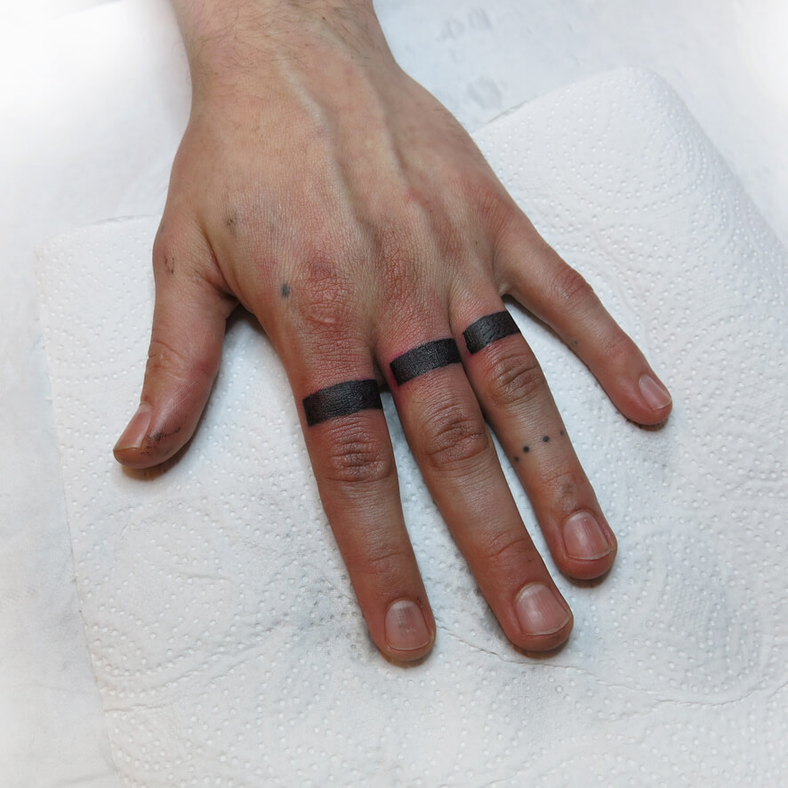 Blackout finger ring tattoos