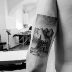 Dotwork tattoo of a hut in the mountains
