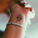 Sugar skull tattoo on the wrist