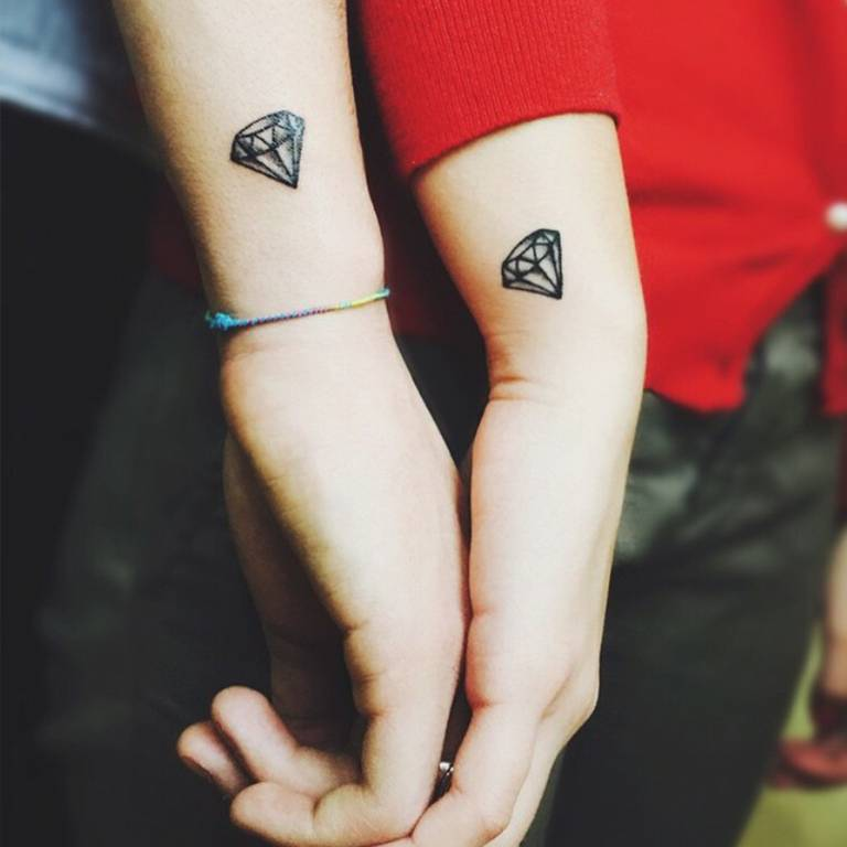 Matching small diamond tattoos