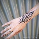Ornamental wrist tattoo by Kris Davidson