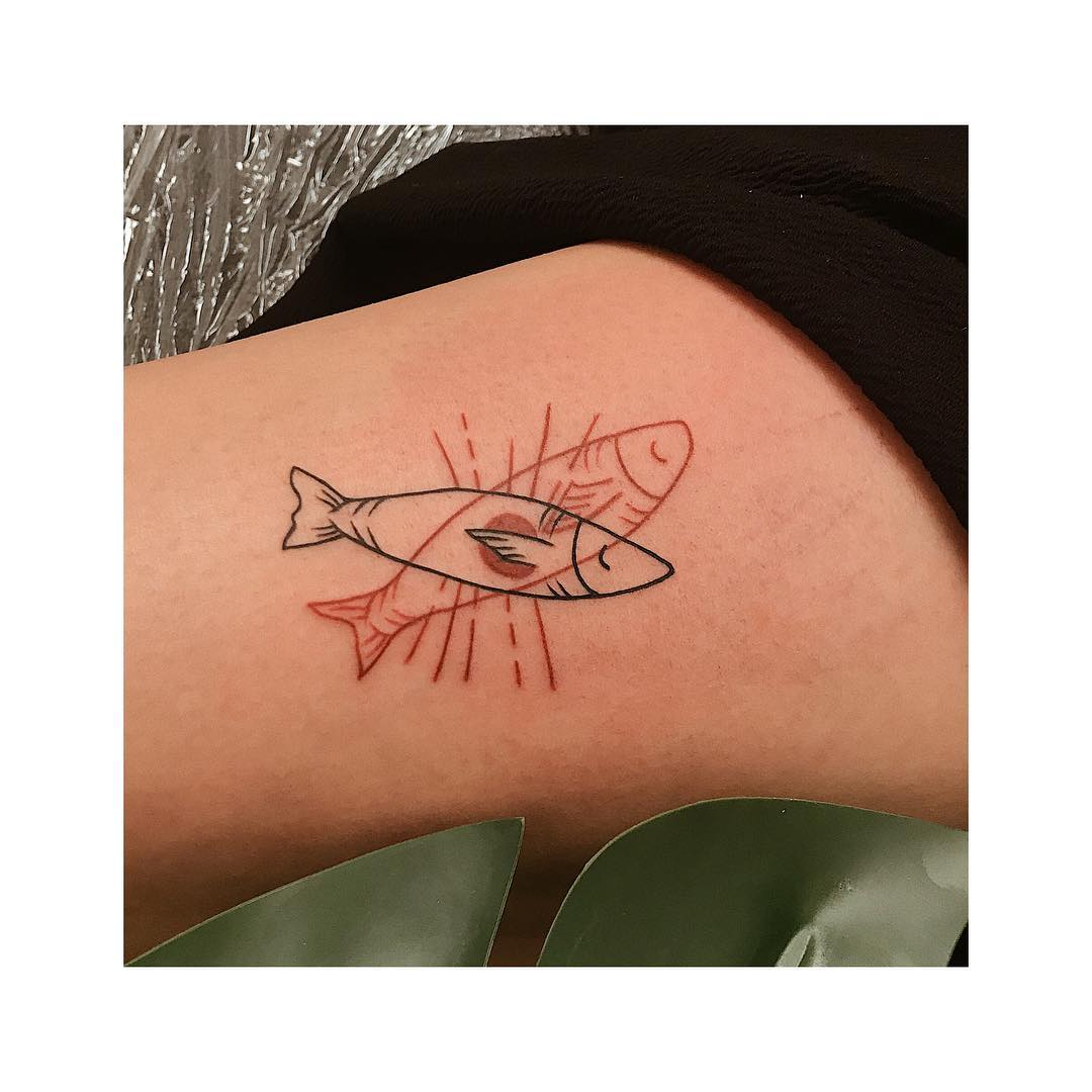 Black and red fish tattoo