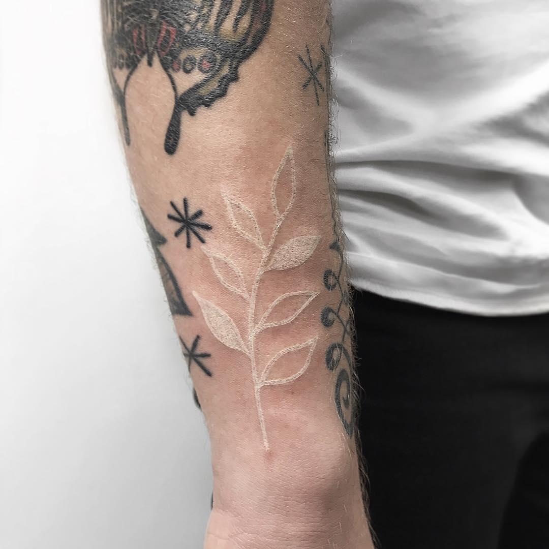 White leaf tattoo by Łukasz Krupiński
