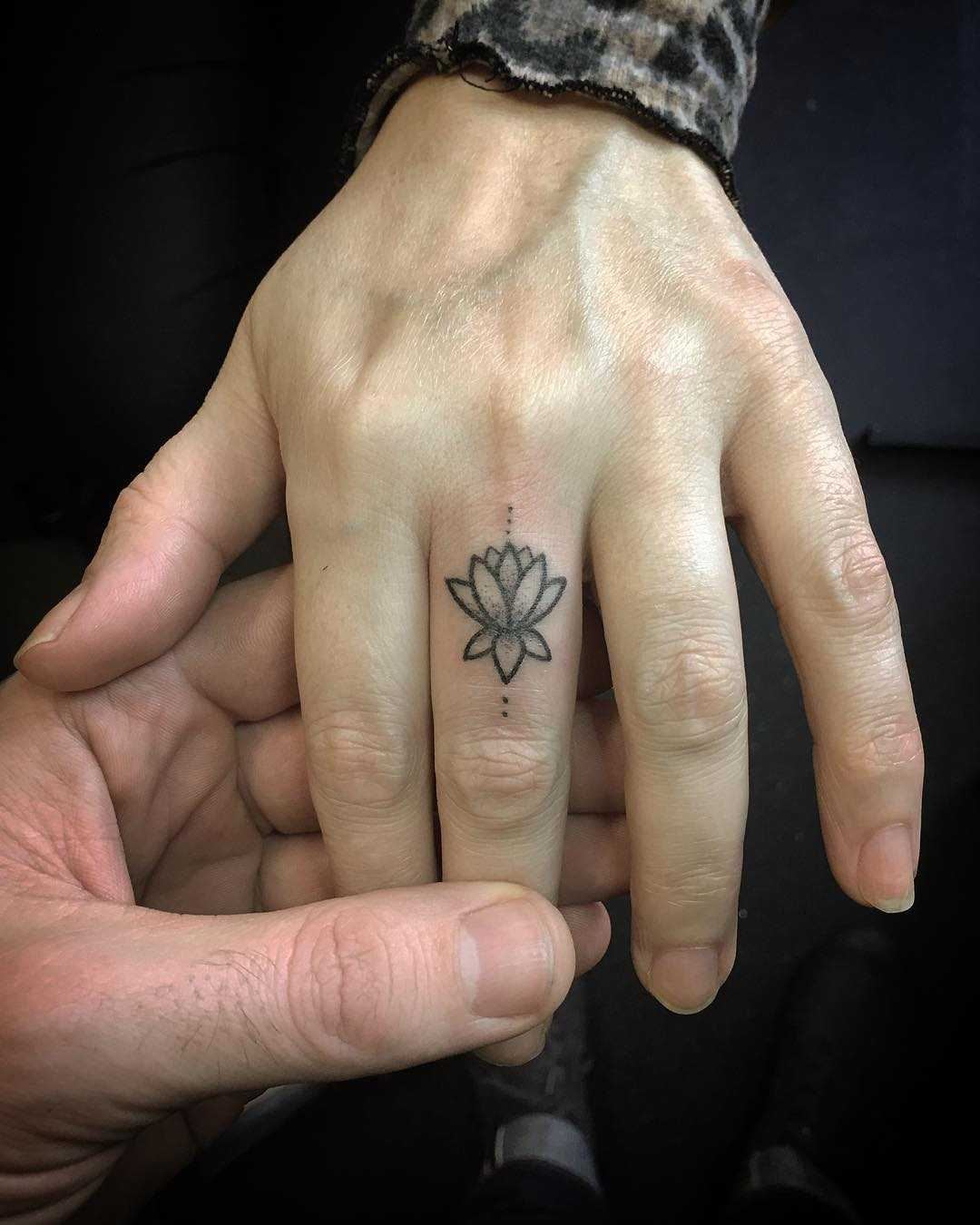 Tiny Lotus on the finger by Kirk Budden
