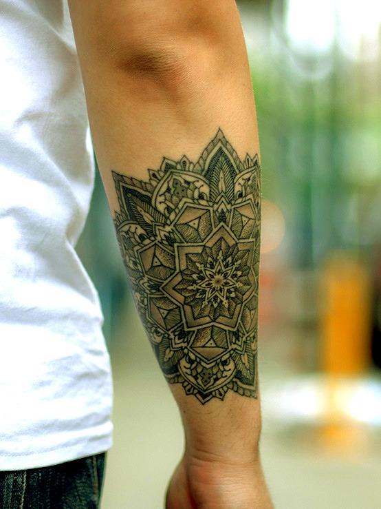 Beautiful mandala tattoo on the forearm