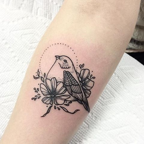 Bird tattoo on the arm