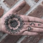 Black Mandala tattoo on the palm