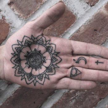 Black Mandala tattoo on the palm