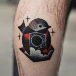 Black and red bird tattoo