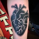Black and white heart tattoo
