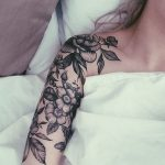 Black floral sleeve tattoo