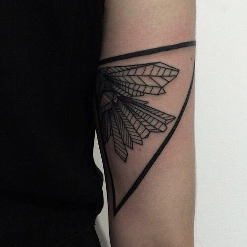 Black geometric tattoo on the arm