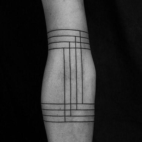 Black lines tattoo on the arm