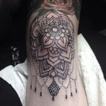Black mandala tattoo on the knee