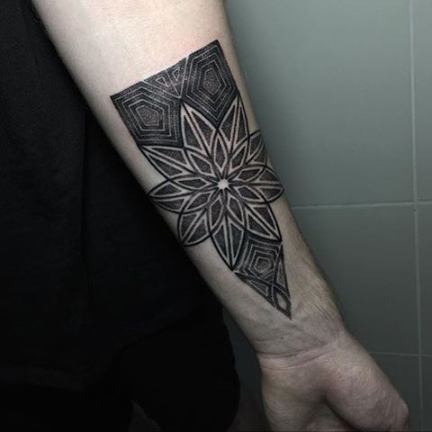 Black mandala tattoo on the wrist