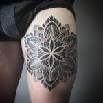 Black mandala tattoo on thigh