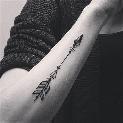 Black minimal arrow tattoo on the forearm