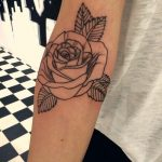 Black outline rose tattoo