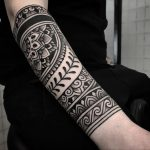 Black pattern tattoo on the forearm