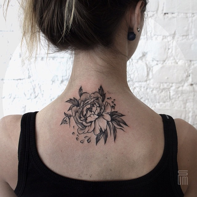 Black rose tattoo on the neck