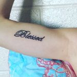 Blessed word tattoo