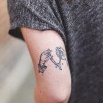 Breaking a wishbone tattoo
