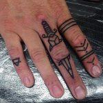 Dagger tattoo on the finger