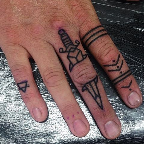 Dagger tattoo on the finger