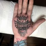 Devil tattoo on the palm