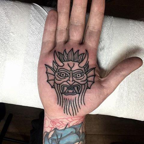 Devil tattoo on the palm