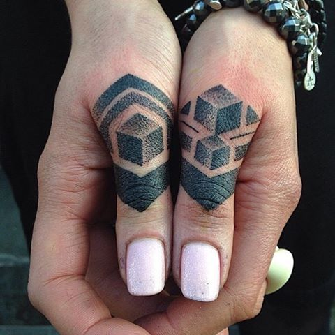 Dot-work geometric tattoos on fingers