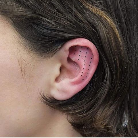 Dots tattoo on the ear