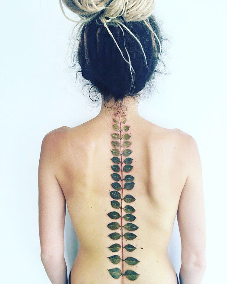Fern leaf tattoo on the spine