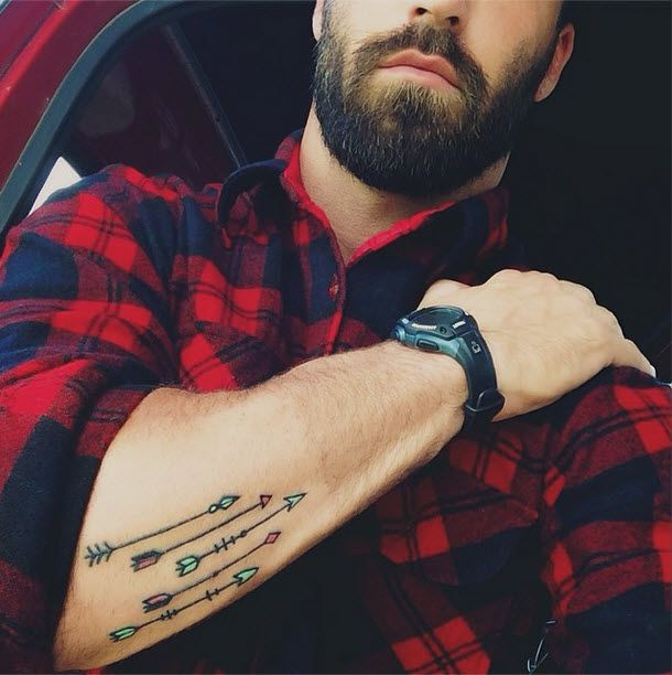 Five minimal arrows tattoo on the forearm