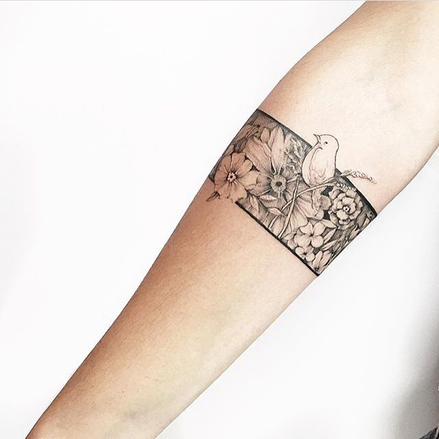 Floral Bracelet Tattoo With A Bird Tattoogrid Net If you're thinking about getting a bracelet tattoo then you came to the right place. floral bracelet tattoo with a bird
