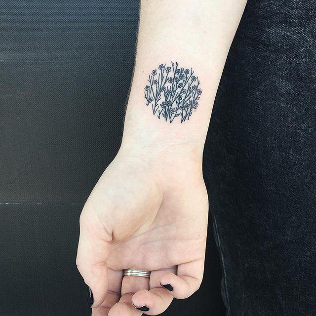 Floral circle tattoo