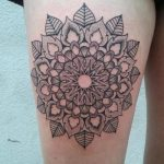 Floral mandala tattoo on the thigh