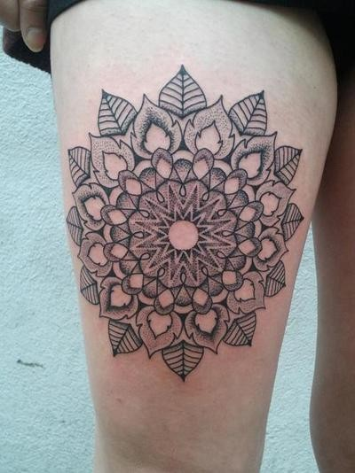 Floral mandala tattoo on the thigh