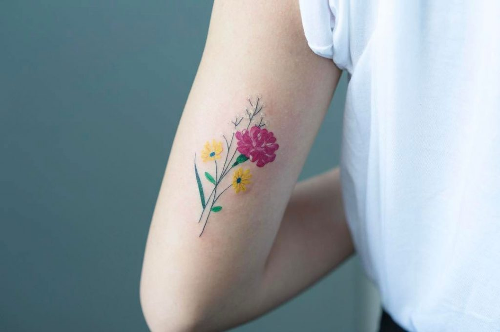 Flower bouquet tattoo on the arm