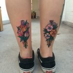 Flower bouquet tattoos on the calfs