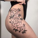 Flower tattoo on the hip