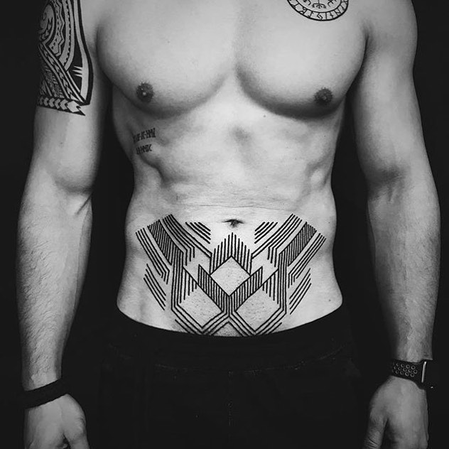 Geometric tattoo on the belly