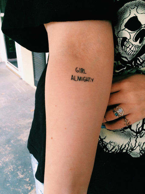 Girl almighty quote tattoo on the inner arm