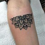 Half mandala tattoo on the inner arm