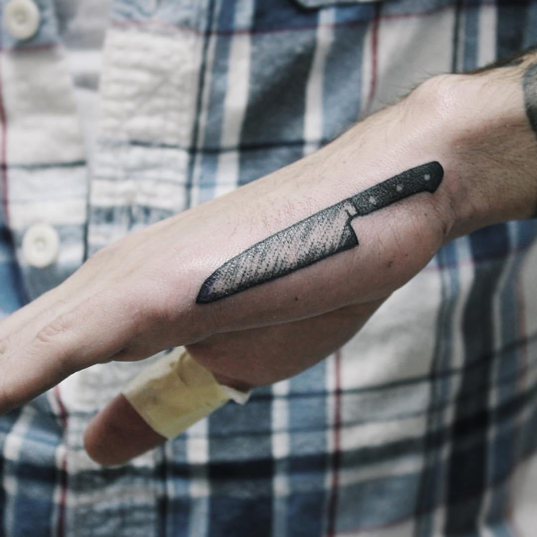 Knife tattoo