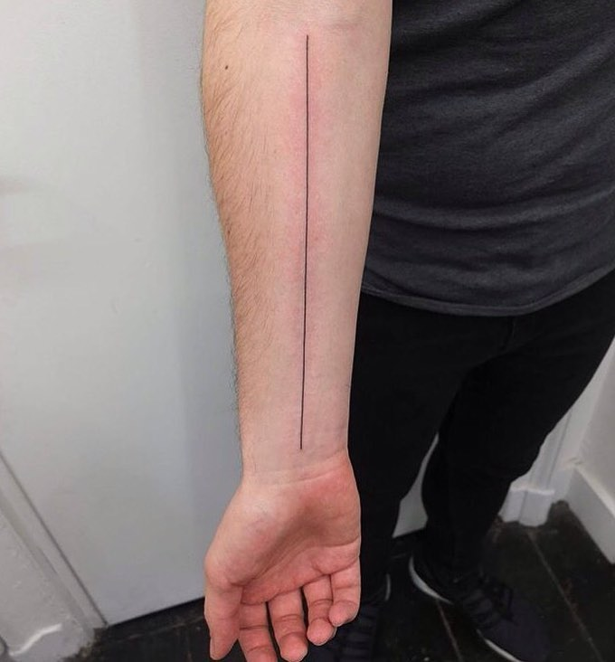 Long thin line tattoo