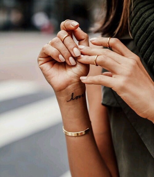 Love tattoo on the wrist