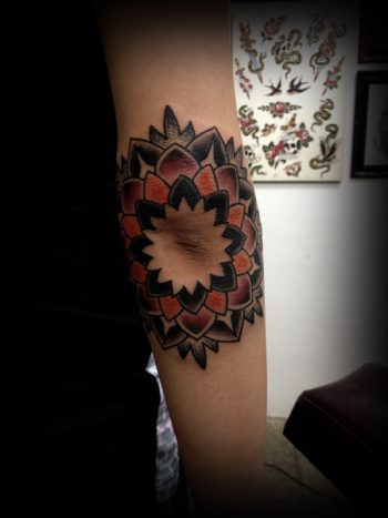 Mandala tattoo around the elbow