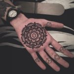 Mandala tattoo on palm