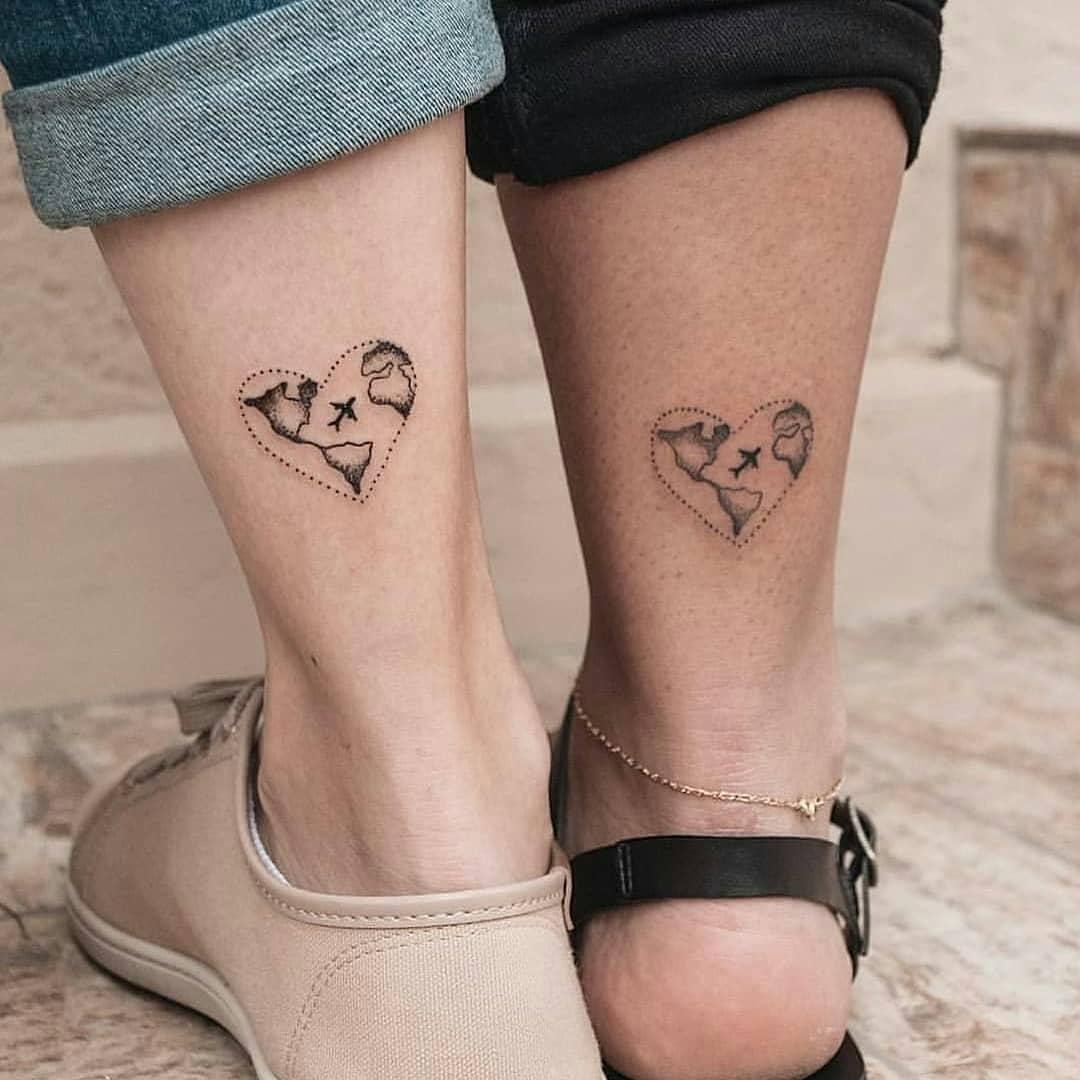 Matching heart tattoos on legs